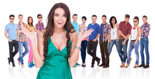 Excited woman in front of a group of casual people stock photos