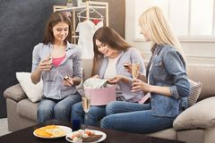 Excited woman getting gift from her friends. Excited women getting present from her friends. Celebration, henparty before wedding and female friendship concept Royalty Free Stock Images