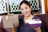 Excited woman with gift boxes Royalty Free Stock Photography
