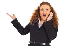 Excited woman with great news at cellphone Stock Photo