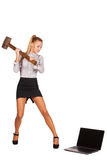 Excited woman with a hammer smashes laptop Stock Photos