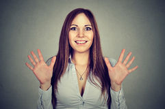 Excited woman with hands up near her face smiling Stock Photo