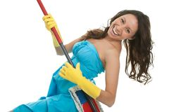 Excited woman having fun while cleaning Stock Photo