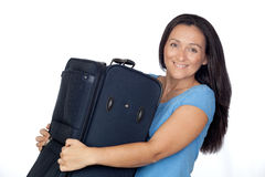 Excited woman with a heavy suitcase Royalty Free Stock Photos