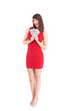 Excited woman holding american dollars Stock Photos
