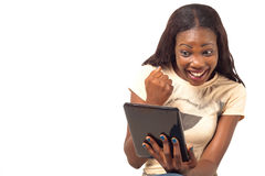 Excited woman holding digital tablet. African American woman excited holding digital tablet PC stock photos