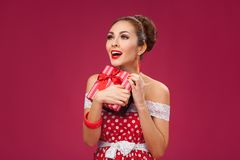 Excited Woman Holding Gift Box. Pin-up retro style Stock Photos