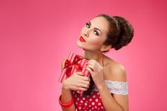 Excited Woman Holding Gift Box. Pin-up retro style Royalty Free Stock Photos