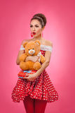 Excited Woman Holding Gift Box and Teddy Bear Stock Image