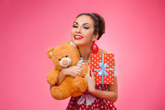 Excited Woman Holding Gift Box and Teddy Bear Royalty Free Stock Photos