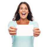 Excited woman holding gift card. Happy Young amazed female holding blank card Royalty Free Stock Photos