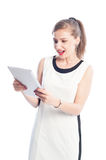 Excited woman holding and looking at tablet Royalty Free Stock Photos