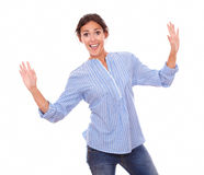 Excited woman holding up her hands Stock Photos