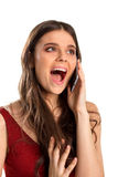 Excited woman holds cell phone. Stock Images