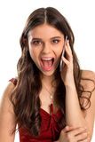 Excited woman holds a phone. Royalty Free Stock Images