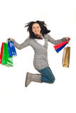 Excited woman jump with shopping bags Royalty Free Stock Photography