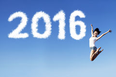 Excited woman jumping on the air with numbers 2016 Royalty Free Stock Image