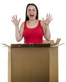 Excited woman jumping out from inside box Stock Photos