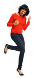 Excited woman jumps in joy Stock Images