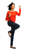 Excited woman jumps in joy Royalty Free Stock Photos