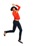 Excited woman jumps in joy Stock Image