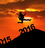 Excited woman jumps over 2016 numbers Stock Images