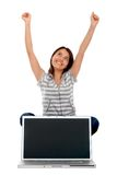 Excited woman with laptop Stock Images