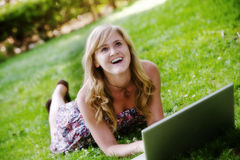 Excited Woman on Laptop. An excited woman on a laptop looks up Royalty Free Stock Photo