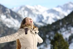 Excited woman laughing in the mountain Stock Images
