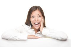 Excited woman leaning on empty white board. Woman billboard sign. Young beautiful woman surprised showing blank white placard. Excited expression by young Asian Royalty Free Stock Photos