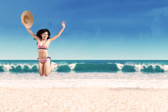 Excited woman leaping at beach 2 Stock Image