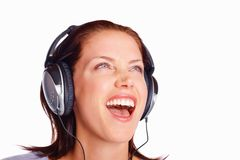 Excited woman listening to music while looking up Royalty Free Stock Image