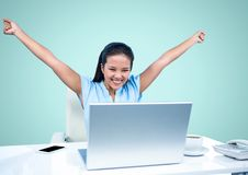 Excited woman looking at laptop. Digital composition of excited woman sitting at desk and looking at laptop Royalty Free Stock Photo