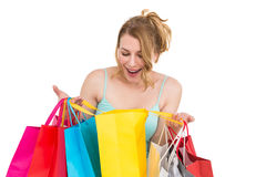 Excited woman looking at many shopping bags. On white background Stock Photos