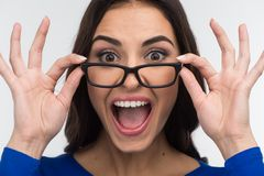 Excited woman looking and screaming of joy. Stock Photos