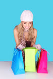 Excited Woman Looking In Shopping Bag Royalty Free Stock Images