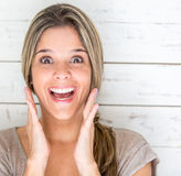 Excited woman looking surprised Stock Photo