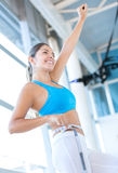 Excited woman loosing weight Stock Photos