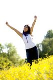 Excited woman in a meadow Royalty Free Stock Photography