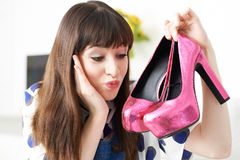 Excited Woman With New Pair Of Shoes. Excited Woman Holds New Pair Of Shoes Stock Photography