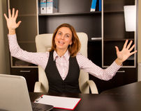 Excited Woman in office Royalty Free Stock Photo