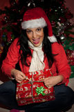 Excited woman open a Christmas present Royalty Free Stock Images
