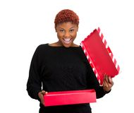 Excited woman opening gift box Stock Photos