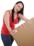 Excited woman opening a parcel Stock Images