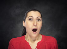 Excited woman over dark background Royalty Free Stock Images
