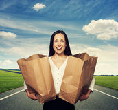 Excited woman with paper bags at outdoor Stock Photography