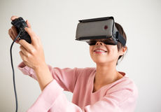 Excited Woman play game virtual reality device Stock Photo