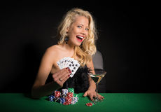 Excited woman playing poker Stock Images