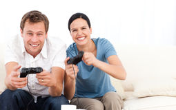 Excited woman playing video games Royalty Free Stock Image