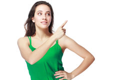 Excited woman point Stock Images